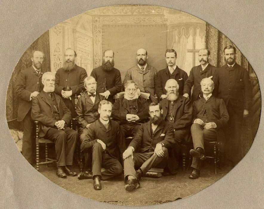 St Matthew's Church Sunday School teachers with Canon Dixon, Rugby.  1888.  From left to right, back row: W. Phillips; Mr Dawson; Revd W.O. Wait; Mr Trench; W. Puxley; S. Bosworth; Mr Harrison.  Middle row: Mr. Darkin; Mr Harwood; Revd Canon R. Dixon; J. Alcott; Mr Molineux.  Front row: J.E.C. Foxon and C. Snewing.    IMAGE LOCATION: (Rugby Library) PEOPLE IN PHOTO: Wait as a surname, Wait, Revd W O, Trench, Mr, Trench as a surname, Snewing, C, Snewing as a surname, Phillips, Mr W, Phillips as a surname, Molineux, Mr, Molineux as a surname, Harwood, Mr, Harwood as a surname, Foxon as a surname, Foxon, J E C, Dixon, Revd Canon R, Dixon as surname, Dawson, Mr, Dawson as a surname, Darkin, Mr, Darkin as a surname, Bosworth, S, Bosworth as a surname, Alcott, J, Alcott as a surname