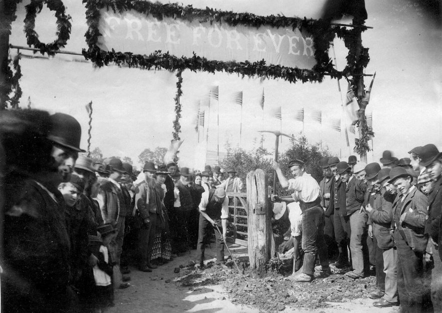 Celebration at the opening of the bridges to free access at Binton on the 26th of April 1893.  This shows the workmen removing the toll gates, prior to a public luncheon at the Four Alls.  1893 |  IMAGE LOCATION: (Warwickshire County Record Office)