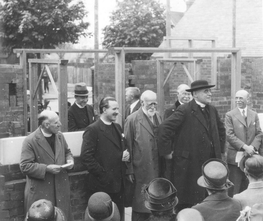 Laying of the foundation stone of the Methodist church in Dunsmore Avenue, Rugby.  Left to right, back row: Rev. Leslie Graig; Mr W. Skinner; Rev Samuel Boddy; Rev F.S. Corby; Rev Walter Dockery; Mr J. Ferry; Rev F.W. Benson (Chairman of Birmingham District); and Mr J. Darby.  1930 |  IMAGE LOCATION: (Rugby Library) PEOPLE IN PHOTO: Skinner, Mr W, Skinner as asurname, Grant as a surnam, Graig, Revd Leslie, Ferry, Mr J, Ferry as asurname, Dockery, Revd Walter, Dockery as asurname, Darby, Mr J, Darby as a surname, Corby, Revd F S, Corby as a surname, Boddy, Revd Samuel, Boddy as a surname, Benson as a surname, Benson, Revd F W