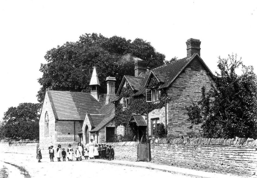 The school and schoolhouse at Binton with the pupils outside.  1900s |  IMAGE LOCATION: (Warwickshire County Record Office)