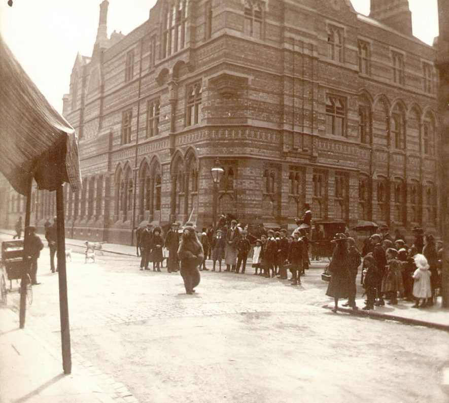 Dancing bear in St Matthew's Street during visit of Bostock and Wombwell's Menagerie, Rugby.  1910 |  IMAGE LOCATION: (Rugby Library)
