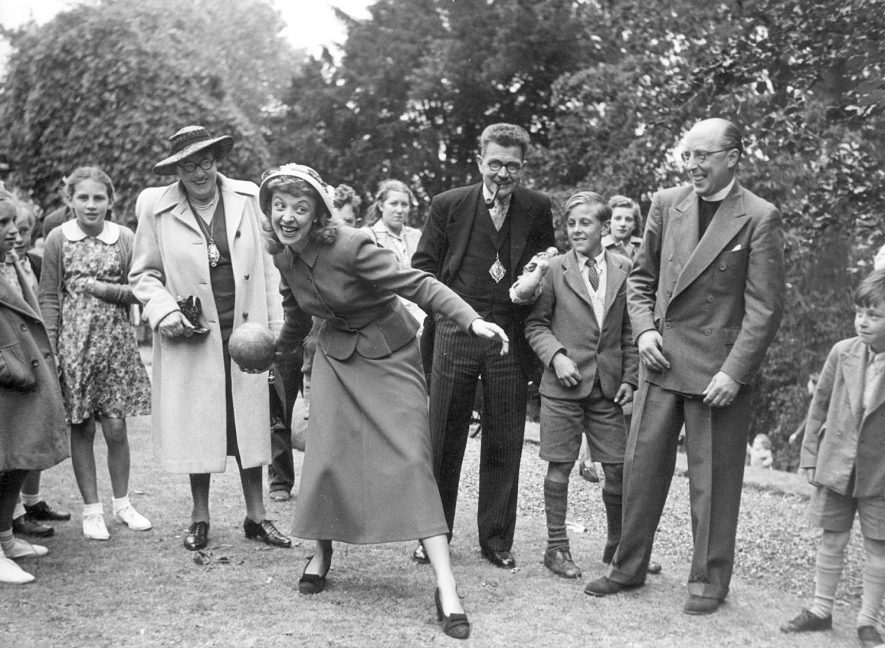 Newbold on Avon church fete, Rugby, featuring Miss Joy Nichols of the BBC trying bowling before the Mayor and Mayoress and the Vicar, Councillor and Mrs Lord and Rev Powell.  1948 |  IMAGE LOCATION: (Rugby Library) PEOPLE IN PHOTO: Powell, Revd C T P, Powell as a surname, Nichols as a surname, Nichols, Miss Joy, Lord, Mrs, Lord as a surname