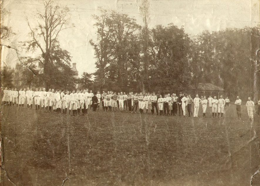 A crowd of pupils presumably about to play rugby football at Rugby School.  1850s |  IMAGE LOCATION: (Rugby Library)