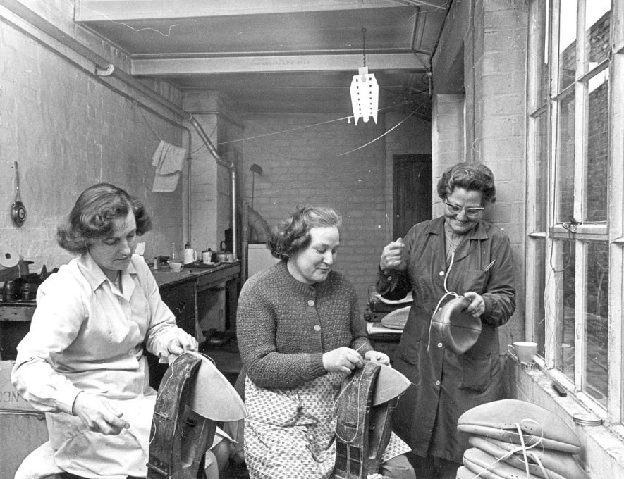 Mrs Phyllis Barratt, Mrs Maria Stebnyckyj and Mrs Emily Souster making rugby footballs at J. Gilbert's, football manufacturers in Rugby.  February 14th 1969  Photograph supplied by kind permission of the Rugby Advertiser. |  IMAGE LOCATION: (Rugby Library) PEOPLE IN PHOTO: Stebnyckyj, Mrs Maria, Stebnyckyj as a surname, Souster, Mrs Emily, Souster as a surname, Barratt, Mrs Phyllis, Barratt as a surname