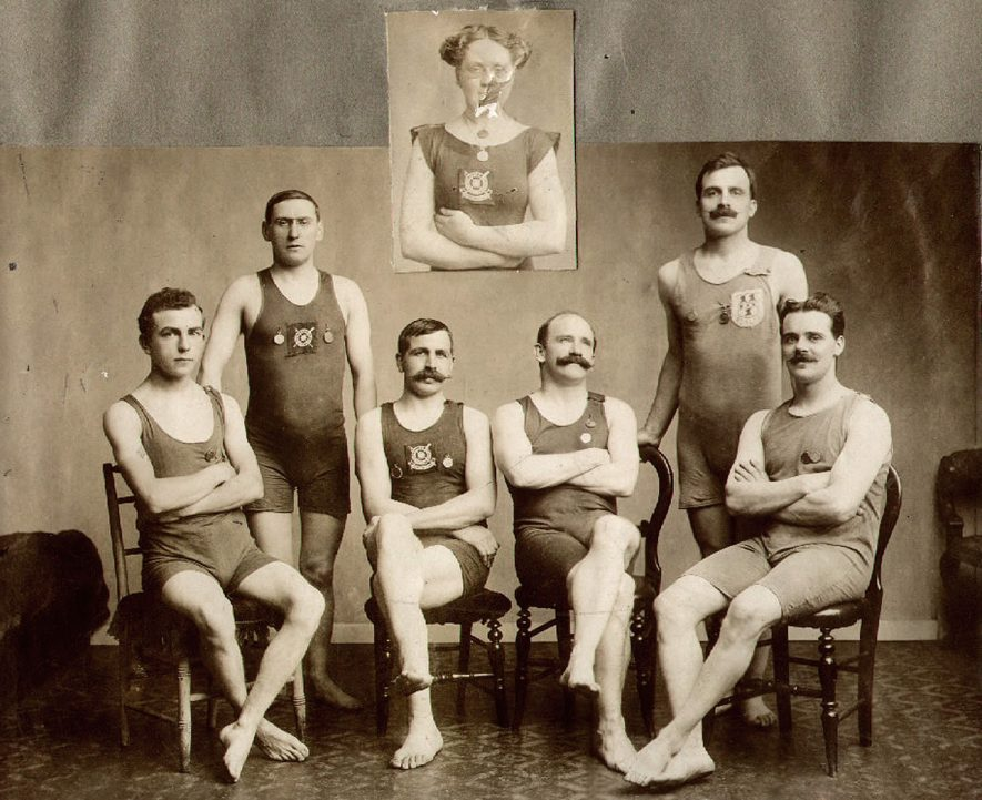 Rugby Swimming and Life Saving Society members who were the winners of the Award of Merit in 1912. Standing - F.G Wroot, W.J Verrier. Seated, left to right - F.C Shillitoe, S. Smithies, W.J Rouse, W.P Cowley. Inset - Mrs E Smithies. |  IMAGE LOCATION: (Rugby Library) PEOPLE IN PHOTO: Wroot, F G, Wroot as a surname, Verrier, W J, Verrier as a surname, Smithies, S, Smithies, Mrs E, Smithies as a surname, Shillitoe, F C, Shillitoe as a surname, Rouse, W J, Rouse as a surname, Cowley, W P, Cowley as a surname