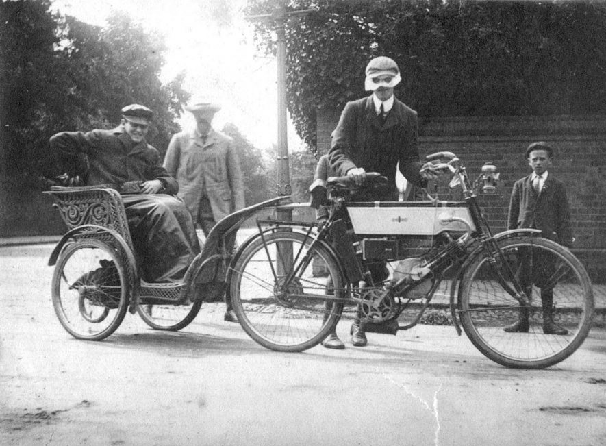 The Dewar family setting out for Perth, Scotland, on an early motorcycle, Rugby.  1902 |  IMAGE LOCATION: (Rugby Library) PEOPLE IN PHOTO: Dewar as a surname