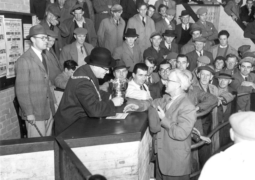 The Mayor Alderman L B Fox presenting  the Championship Cup to Mr H Davies at Rugby  Annual Dairy Show.  1957 |  IMAGE LOCATION: (Rugby Library) PEOPLE IN PHOTO: Fox, Ald L B, Fox as a surname, Davies, Mr H, Davies as a surname