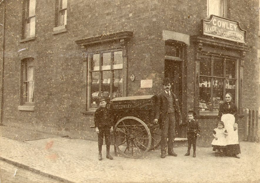 Mr and Mrs Cowley outside Cowley's bakers shop at the corner of Sun Street and Cambridge Street, Rugby.  1889 |  IMAGE LOCATION: (Rugby Library) PEOPLE IN PHOTO: Cowley, Mr & Mrs H R, Cowley as a surname