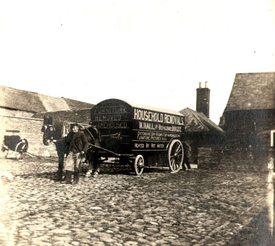 Henry Hall's horse drawn furniture removal van in  Albert Street, Rugby.  1900s |  IMAGE LOCATION: (Rugby Library) PEOPLE IN PHOTO: Hall, Henry, Hall as a surname