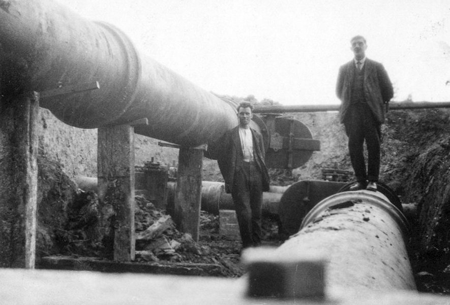 Foreman of construction firm standing on new mains at Rugby Gas Works.  1929    IMAGE LOCATION: (Rugby Library)