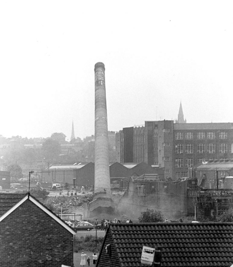 Demolition of the chimney situated at the large machine site of G.E.C, Boughton Road, Rugby.  1991  Photograph supplied by kind permission of the Rugby Advertiser.    IMAGE LOCATION: (Rugby Library)