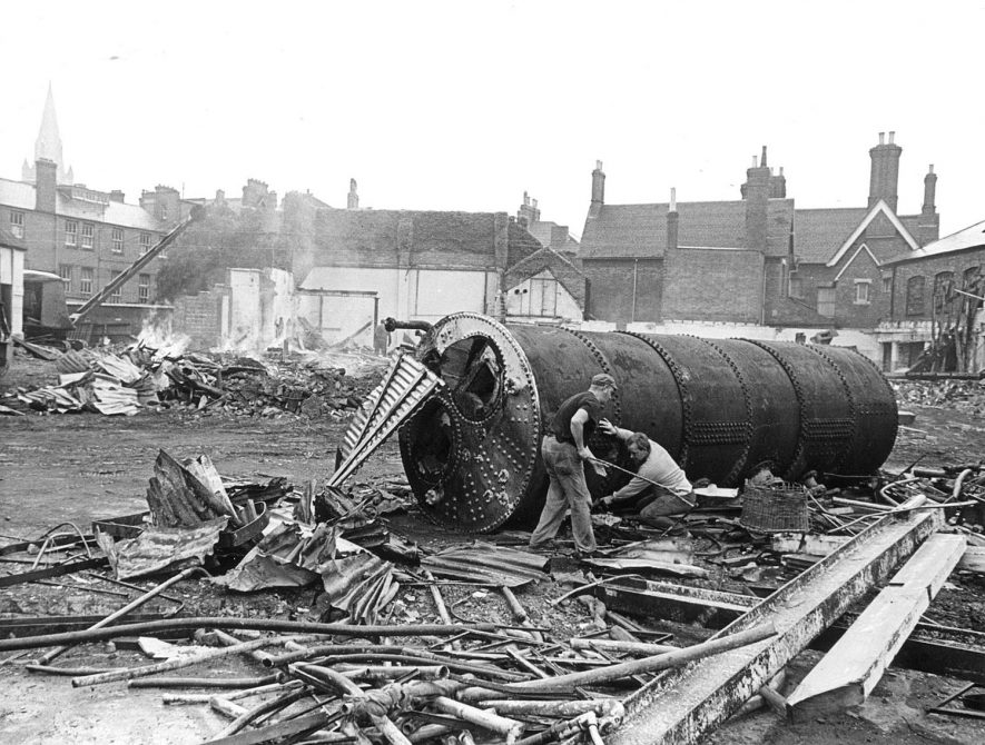 Clearing of Foster & Dicksee's builders yard in James Street, Rugby, in preparation for the site to be used as a car park.  August 15th 1969  Photograph supplied by kind permission of the Rugby Advertiser. |  IMAGE LOCATION: (Rugby Library)