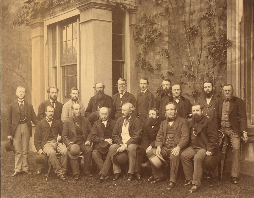 Rugby Art & Industry exhibition committee members. The exhibition was held in the Town Hall in 1873. Standing, left to right - Frederick Wright, William Phillips, J.W Kenning, Joseph Alcott, Peter Simpson, William Bryant, John Tait, Thomas Henderson, Roland Tait and J.B Over. Seated - George Charleton, J.E Palmer, T.N Hutchinson, Lt. Col. Forbes MacBean, F.E Kitchener, Henry Kelham and W.C Tait. |  IMAGE LOCATION: (Rugby Library) PEOPLE IN PHOTO: Wright, Frederick, Wright as a surname, Tait, W C, Tait, Roland, Tait, John, Tait as a surname, Simpson, Peter, Simpson as a surname, Phillips, William, Phillips as a surname, Palmer, J E, Palmer as a surname, Over, J B, Over as a surname, Kenning, J W, Kenning as a surname, Kelham, Henry, Kelham as a surname, Henderson, Thomas, Henderson as a surname, Forbes Macbean, Lt Col, Forbes as a surname, Charleton, George, Charleton as a surname, Bryant, William, Bryant as a surname, Alcott, Joseph, Alcott as a surname