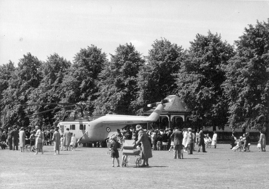 Helicopter of H.M. Queen Elizabeth, the Queen Mother in the recreation ground, Hillmorton Road, Rugby. She had come to open the Town Hall.  July 5th 1961    IMAGE LOCATION: (Rugby Library)