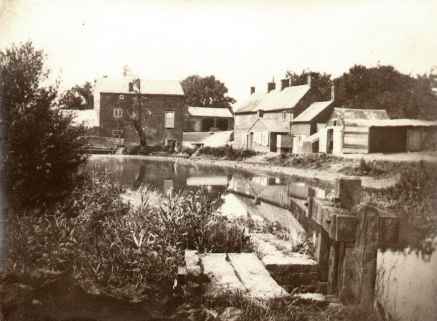 Brownsover Mill,  which stood on the River Avon was thought to be between 150 and 200 years old.  It was burned down on January 22nd, 1956.  The nearby reservoir was made in 1902 by enlarging the original pool.  This photograph was probably taken c.1900-1910 |  IMAGE LOCATION: (Rugby Library)