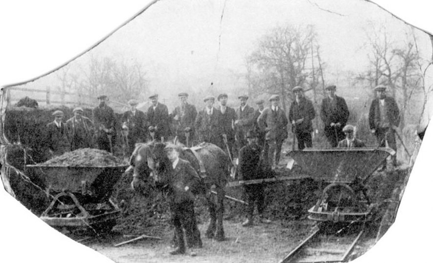 The scene at Brook Bridge where a new road is being made showing horse-drawn trolleys filled with earth, Bishops Tachbrook.  1921 |  IMAGE LOCATION: (Warwickshire County Record Office)