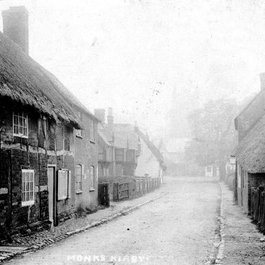 Monks Kirby.  Village street and thatched cottages