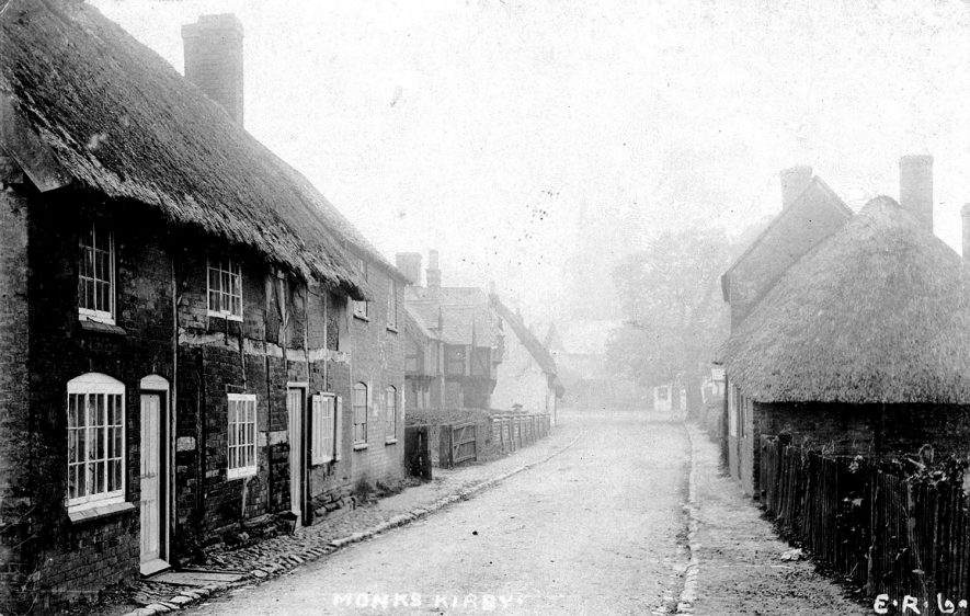 Village street and thatched cottages in Monks Kirby.  1910s |  IMAGE LOCATION: (Warwickshire County Record Office)