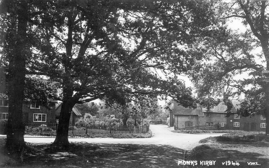 A view of Monks Kirby cottages through the trees.  1950s |  IMAGE LOCATION: (Warwickshire County Record Office)