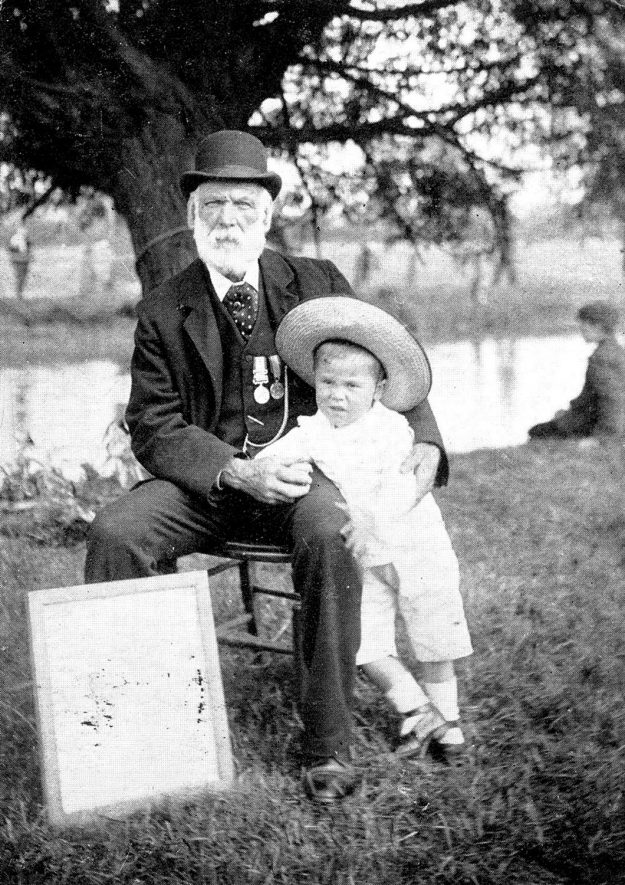 Mr. Joseph Norman and the child he saved from drowning at Brownsover, Rugby.  1905 |  IMAGE LOCATION: (Warwickshire County Record Office) PEOPLE IN PHOTO: Norman as a surname, Norman, Joseph
