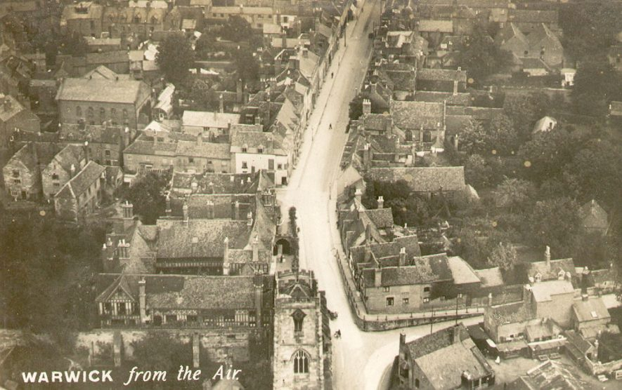 High Street, Warwick, photographed from the air, showing the Lord Leycester Hospital on the left.  1920s |  IMAGE LOCATION: (Warwickshire County Record Office)