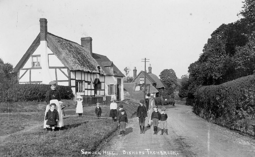 School Hill, Bishops Tachbrook. Black and white thatched timbered cottage.  1900s |  IMAGE LOCATION: (Warwickshire County Record Office)