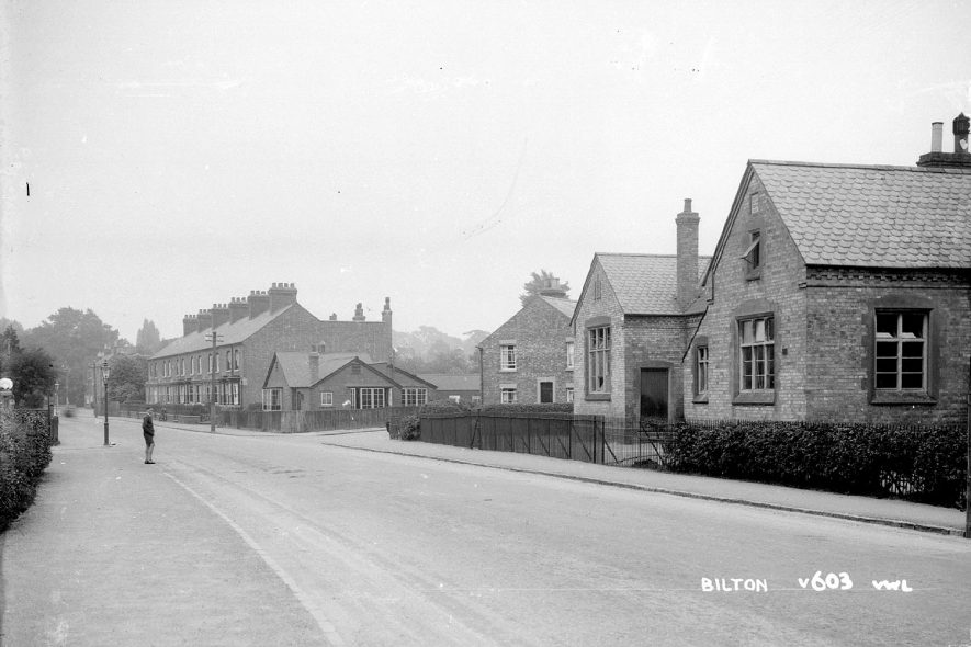 A village street in Bilton with a school on the right.  1930s |  IMAGE LOCATION: (Warwickshire County Record Office)
