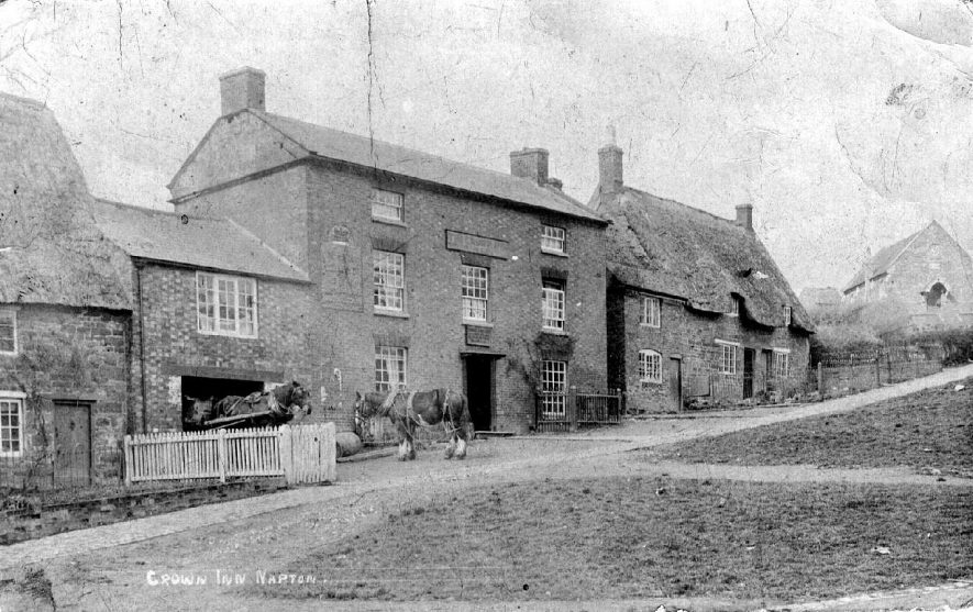 Crown Inn, showing two cart horses, one pulling a cart, Napton on the Hill.  1900s |  IMAGE LOCATION: (Warwickshire County Record Office)