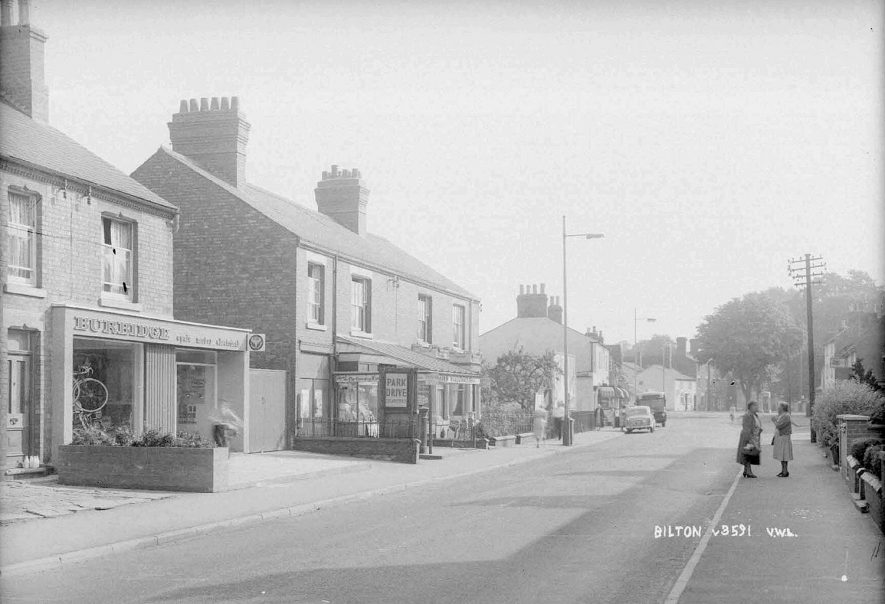 A street scene in Bilton including a cycle shop and post office.  1930s |  IMAGE LOCATION: (Warwickshire County Record Office)