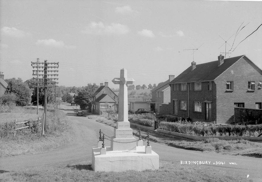 Birdingbury War Memorial. 1940s[The first of the older houses in the background was split into three businesses, a shop, a bakery (the bit visible in the photograph) and a wash-house)The land at the back of the house was the village rubish tip} |  IMAGE LOCATION: (Warwickshire County Record Office)