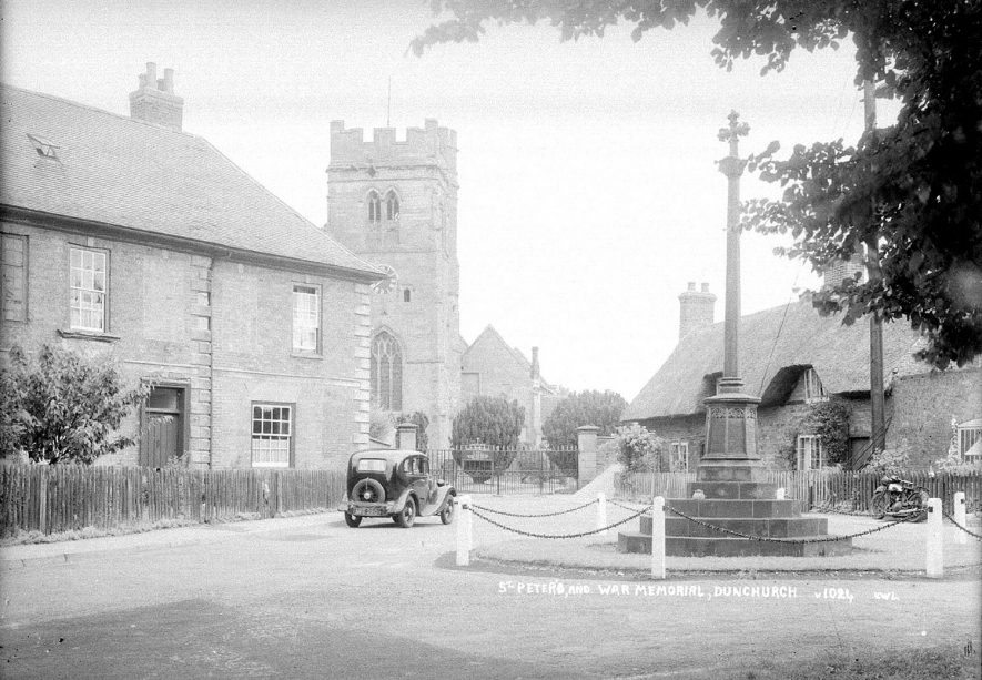 Dunchurch War memorial with the church in the background.  1930s |  IMAGE LOCATION: (Warwickshire County Record Office)