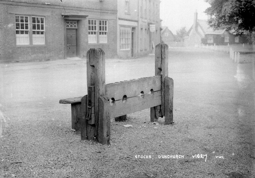 The Village Stocks, Dunchurch.  1930s |  IMAGE LOCATION: (Warwickshire County Record Office)