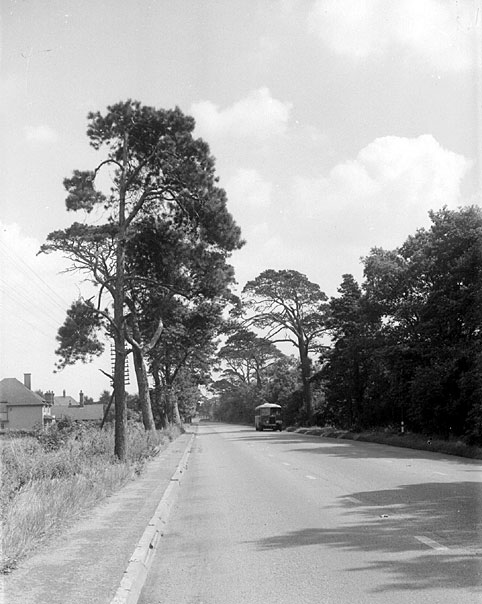 Coventry Road looking east towards  Dunchurch with a bus in the background. Circa 1932  [East of the present day Blue Boar flyover] |  IMAGE LOCATION: (Warwickshire County Record Office)