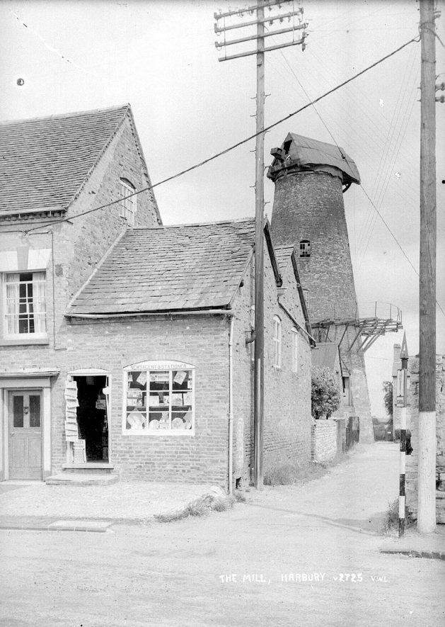 The windmill from Mill Street, showing the newsagent's shop on the corner.  1950s |  IMAGE LOCATION: (Warwickshire County Record Office)