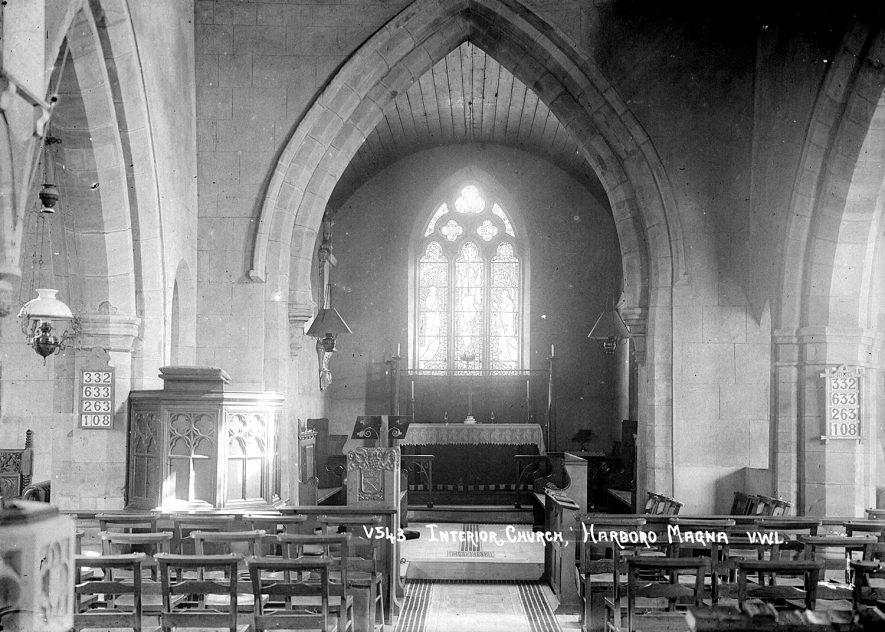The interior of All Saints church showing the chancel and altar from the nave.  1950s |  IMAGE LOCATION: (Warwickshire County Record Office)