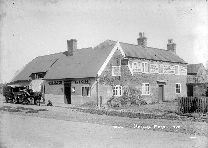 The Golden Lion public house, which sold ales from All Saints Brewery Co Ltd., of Leicester.  The delivery vehicle belonged to Rugby Co-op Society.  1940s |  IMAGE LOCATION: (Warwickshire County Record Office)