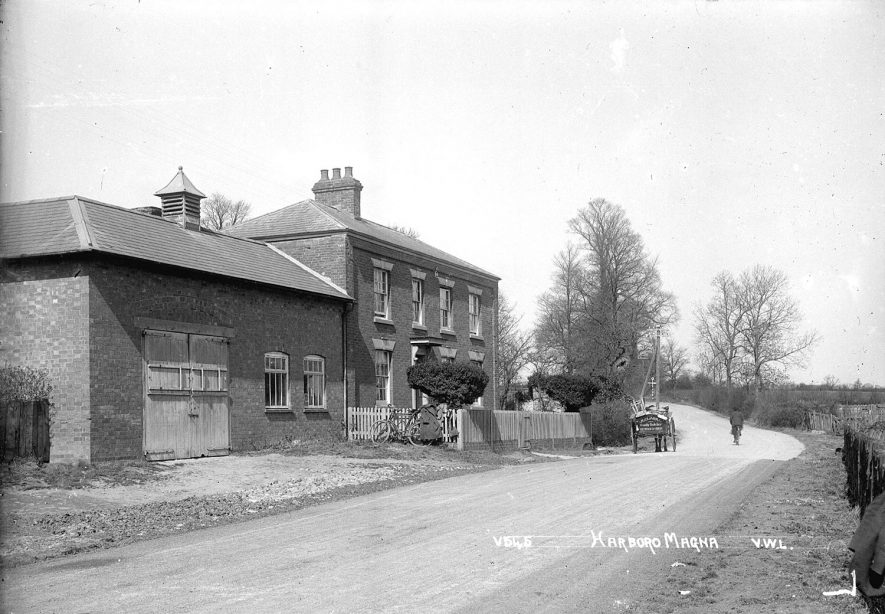 Village street with the horse drawn cart belonging to J.L. Clarke, family butcher, Harborough Magna.  1940s |  IMAGE LOCATION: (Warwickshire County Record Office)