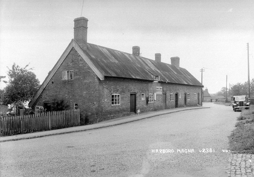 An old shop and cottages in Harborough Magna.  1950s |  IMAGE LOCATION: (Warwickshire County Record Office)