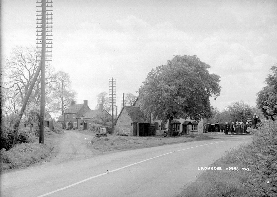 A village scene showing the petrol station, Ladbroke.  1930s    IMAGE LOCATION: (Warwickshire County Record Office)
