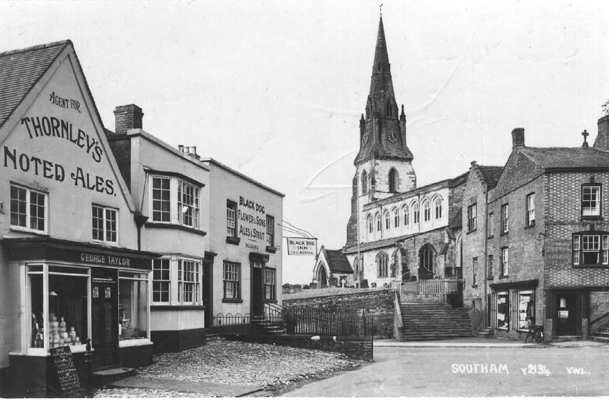 South end of Market Hill, showing the Church, the Black Dog Inn and shops.  1952 |  IMAGE LOCATION: (Warwickshire County Record Office)