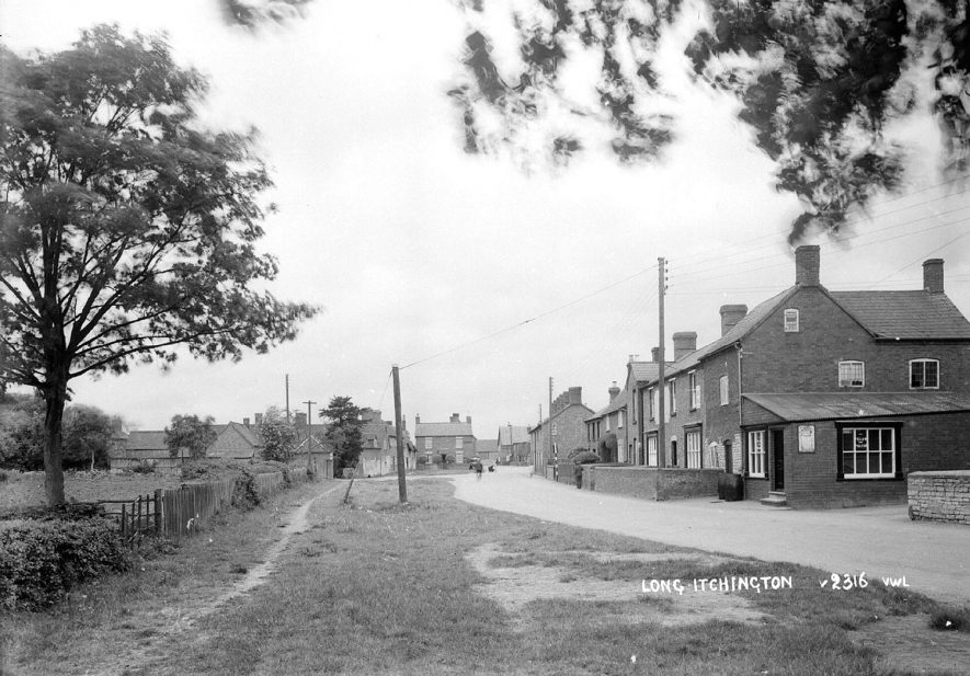 View probably along Church Road, Long Itchington.  1930s [This photo is definitely Church Road, or The Street as it was known by the villagers.The picture is taken adjacent to the westerly gateway to the church, opposite the school. The Co-op is on the right and further on is Brook Tutn leading down to the ford. The building facing the camera in the distance was used one day a week by a bank, possibly The Midland.] |  IMAGE LOCATION: (Warwickshire County Record Office)