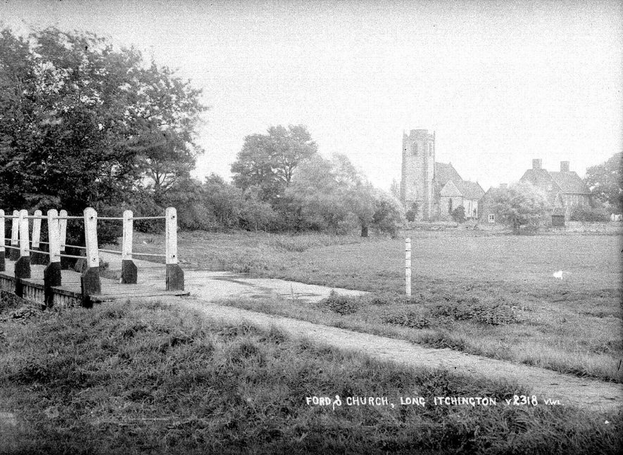 Ford, and church in the distance, Long Itchington.  1930s |  IMAGE LOCATION: (Warwickshire County Record Office)