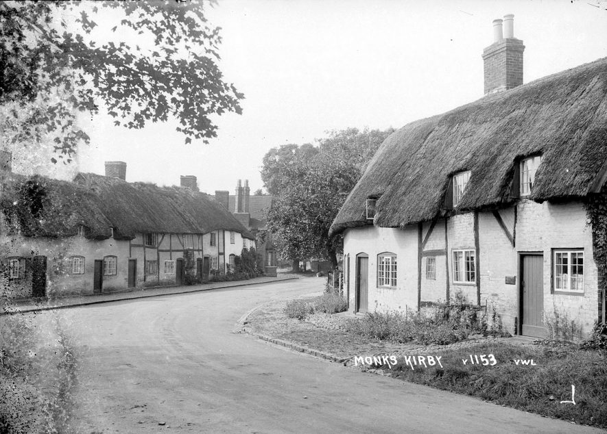 Thatched timber framed cottages in Monks Kirby.  1950s |  IMAGE LOCATION: (Warwickshire County Record Office)
