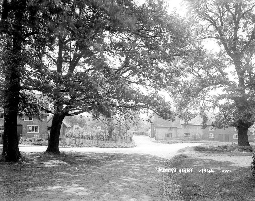 Cottages in Monks Kirby seen through a canopy of trees.  1950s |  IMAGE LOCATION: (Warwickshire County Record Office)