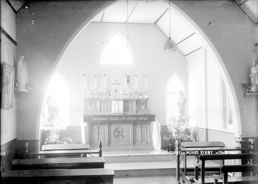 Interior of St Joseph's convent chapel, Monks Kirby, showing the altar.  1930s |  IMAGE LOCATION: (Warwickshire County Record Office)