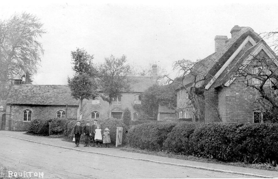 Street scene showing the school and post office, Bourton on Dunsmore.  1900s |  IMAGE LOCATION: (Warwickshire County Record Office)