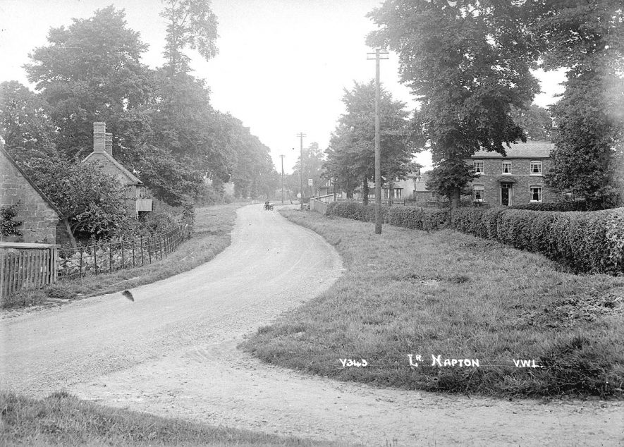 Scene near The King's Head public house, Napton on the Hill.  1920s   [View along Southam Road from the junction with Hillside looking towards the Kings Head and Napton crossroads.] |  IMAGE LOCATION: (Warwickshire County Record Office)