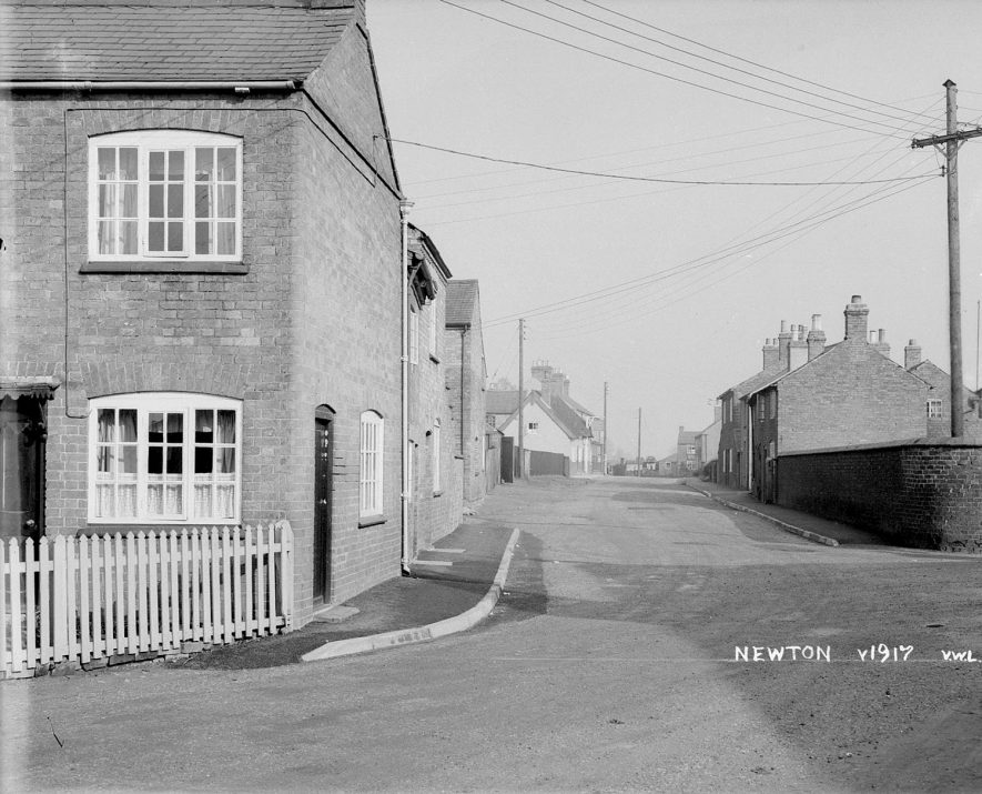 Houses and street in Newton.  1940s |  IMAGE LOCATION: (Warwickshire County Record Office)