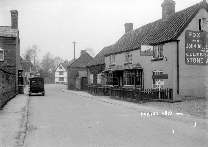 Street with cottages, the Fox Inn and a van parked on the road, Pailton.  1949 |  IMAGE LOCATION: (Warwickshire County Record Office)