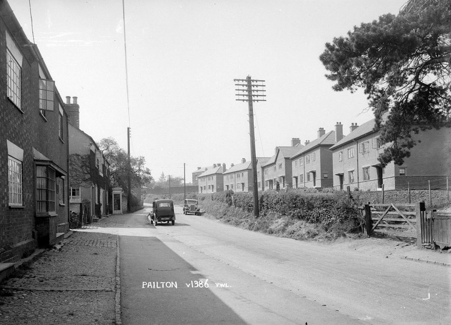 Street with semi-detached housing and cars parked on the road, Pailton.  1939 |  IMAGE LOCATION: (Warwickshire County Record Office)